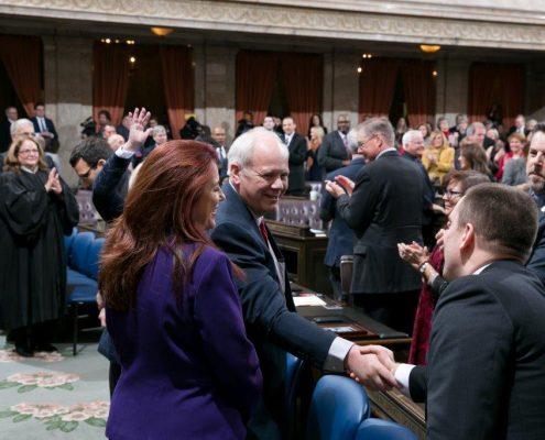 Duane Davidson shaking hands